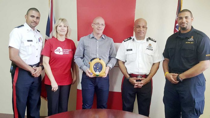 Constable Brandaughn Phillips, Cayman Heart Fund's Colleen Dahlstrom, Heart Fund Chairman David Dinner, Acting Police Commissioner Anthony Ennis and Special Constable Jayse Wilson